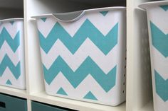 Make your shelves look fantastic on a budget by covering inexpensive plastic bins with the fabric of your choice - great idea! from www.itsalwaysautumn.com
