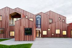 Article source: CEBRA Danish architecture studio CEBRA has completed a pioneering project for a new type of care centre for marginalized children and teenagers in Kerteminde, Denmark. The tile and wood cladded building plays with familiar . Wooden Facade, Wooden Buildings, Architecture Design, Contemporary Architecture, Architecture Today, Timber Architecture, Vernacular Architecture, Commercial Architecture, Building Architecture