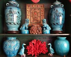 Turquoise and red - a wall display in Charlsie Shine's Florida home