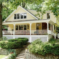 Existing stone terraces starting at the sidewalk and abundant foliage flow right into this new wraparound porch, grounding the addition: http://www.bhg.com/home-improvement/porch/porch/wrap-around-porch-ideas/?socsrc=bhgpin052714existingelements&page=7