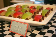 Race car party food. Apple cars with grape wheels.