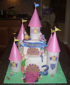 fairy princess tinkerbell castle - cake is buttercream imprinted with pattern.  The turrets, fairies/tinkerbell accents are gumpaste, edible rocks.  this was my first castle cake and I had such a fun time doing it for my neighbor's little girl.  I hope I get to do one for her eldest!