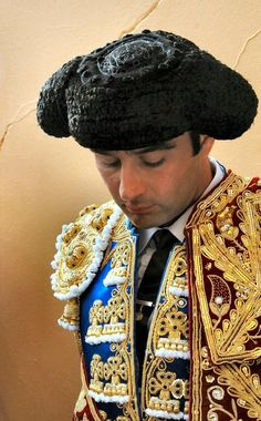 This kind of hat is called Montera, the hat traditionally worn by Bullfighters. The wearing of this ht by bullfighters started in The hat is covered in astrakhan fur with an inner lining of velvet. We Are The World, People Around The World, Around The Worlds, Spanish Hat, Spanish Class, Headdress, Headpiece, Matador Costume, Spain