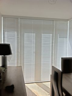 Snow coloured faux wood venetian #blinds ion a set of French doors in #Warrington  http://www.pandablinds.co.uk/blinds-warrington.html