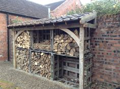 The log store is made out of old scaffolding broads,old slate pallets, recycled roof tiles, dowelled together with tree branches. This is my Diy project to date cant wait to start project no 4 Outdoor Firewood Rack, Firewood Shed, Firewood Storage, Log Shed, Canopy Glass, Log Store, Backyard Sheds, Roof Tiles, Into The Woods