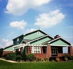 Craftsman Style Bungalow - Brick - Light Grey Trim - Halcyon Green Cedar Shakes - Pergola - Arts & Crafts - Mission -  Design - Well Manicured Lawn - Immaculate Landscaping