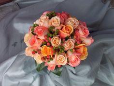 Coral coloured bridal posy