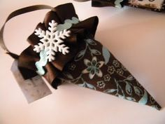 Advent cones: Another pinner gave simpler instructions:Take the fabric and cut out all my cones (pattern included on the site) then  cut  double sided fusing and  iron one piece on each side of it. Hot glue the cone together. Make ruffles, flowers from die cuts and  hot glue it all on.