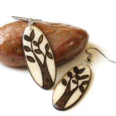 Wood Burned Oval Tree Dangle Earrings - Surgical Steel - Hypoallergenic - Lightweight. $20.00, via Etsy.