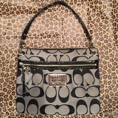 Coach Poppy Crossbody Bag Gently Loved! Black and silver Coach Poppy Crossbody/Shoulder bag. Outside is super clean! Inside is somewhat stained (light pink is HARD to keep clean ) Coach Bags Crossbody Bags