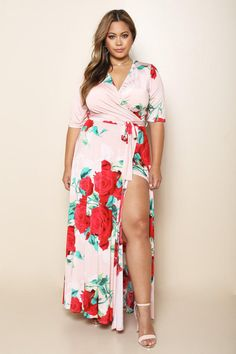A gorgeous and romantic plus size dress with a vibrant rose print design. Features a surplice neckline, elbow sleeves, self-tie belt at the waist, and thigh-high open leg slit for a sexy look. Finished hem at the ankles.