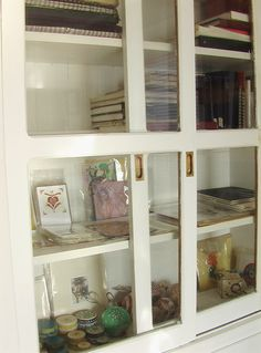 Built in China cabinet housing the original art of artist Jessica Doyle