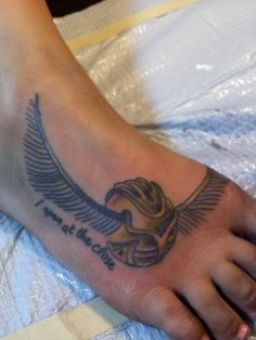 """My golden snitch tattoo. """"I open at the close"""""""