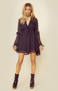 "We're in love with this sweet and feminine mini dress by For Love and Lemons. Featuring a polka dot print throughout, neck tie detail, and ruffled loose fitting sleeves. ImportedDry Clean OnlyPoly ChiffonFit Guide:Model is 5ft 7 inches; Bust: 34"", Waist: 25"", Hips: 35""Model is wearing a size XSRelaxed FitShoes Featured Not Available For Purchase"