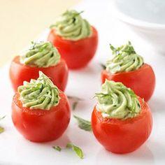 Avocado Pesto-Stuffed Tomatoes - cherry tomatoes, avocado, cream cheese, basil pesto, lemon juice and fresh basil.