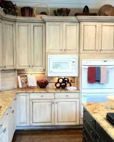 Maybe if I get really brave.... Chalk painted cupboards Photo Credit: Houzz.com