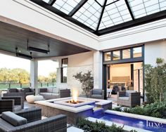 A 1,000-square-foot indoor/outdoor patio with a 20'x20' retractable skylight makes for the perfect entertaining space–rain or shine.  Style On Picture Lifestyle