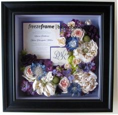 A stunning example of freezedried flowers arranged with the couple's monogram and invitation! http://freezeframeit.com/