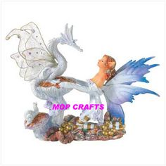 Google Image Result for http://image.made-in-china.com/2f0j00wecamPLKGCqO/Polyresin-Fairy-with-Dragon-Figurine-Resin-Fairy-Dragon.jpg