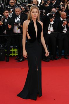 Pin for Later: Every Single Look From the Cannes Film Festival You Just Can't Miss  Doutzen Kroes showed off a black gown with a plunging neckline and bare sides at the Café Society premiere.