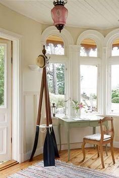 Oar coat rack and vintage glass light