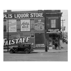 A liquor store covered with advertisements for whiskey and beer. Omaha, Nebraska. 1938.