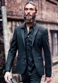 This guy looks like a bad-ass hit man. His facial hair and head hair is the exact opposite. Wavy on top and curly beard. Plus, the suit looks pretty damn cool, too.