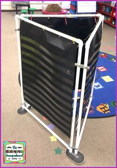 Directions for making a cheap DIY 3 sided pocket chart stand for the classroom. Save space and create more work space with this DIY pocket chart stand. Classroom Hacks, Classroom Layout, Classroom Design, School Classroom, Classroom Decor, Future Classroom, Kindergarten Classroom Organization, Classroom Projects, Classroom Displays