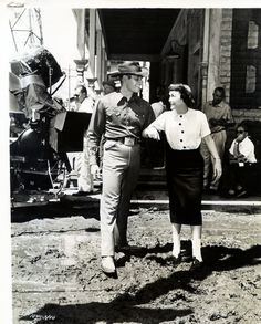 """CHARLTON HESTON and Jane Wyman on the set of ""LUCY GALLANT"" (1956)"