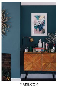 Dark teal painted walls, light wood and colourful accessories makes this alcove pop Dark Wood Living Room, Teal Painted Walls, Teal Walls, Colorful Kitchen Decor, Dark Walls Living Room, Dining Room Teal, Dark Teal Living Room, Teal Walls Living Room, Teal Living Rooms