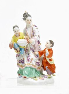 Japanese Lady with Two Children. Meissen. Porcelain, enriched in colours and in gilt. Height 15cm. Condition A. Crossed swords mark, 65646.