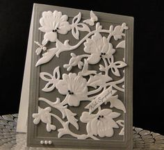 Grey frame border, white is an Anna griffin die, butterfly and bug punches/dies - looks like wedgewood