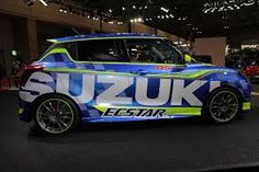 After unveiling the all-new Swift last month, Suzuki has now unleashed the Swift Racer RS. The latter, as you may have guessed, is a racier iteration of the new Swift which has been unveiled at the ongoing Tokyo Auto Salon. New Swift, Suzuki Cars, Suzuki Swift, Jdm, Yamaha, Honda, Vehicles, Image, Design