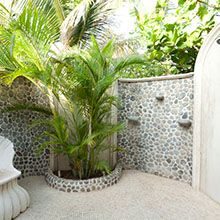 Big outdoor shower with tropical landscaping