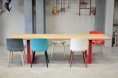 the MAIN table in solid OAK, dressed up with red'dish powder coated steel legs.