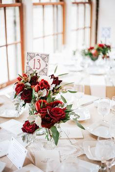 Love the simplicity of this -- white with a POP of RED.  Always PERFECT!  Nothing is more romantic than red roses, in a bouquet and on the wedding reception dining tables.  Classic and classy all the way <3