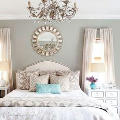 Cute bedroom.. But made one major mistake .. Lost me with the drapes they should be ceiling height with more volume they just look cheap ... Just my opinion