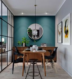 Neutral colour palette with a twist - Elegant dining room kept in neutral, dimmed colours like gray, black and brown with a twist of a beautiful petroleum-green colour on wall.