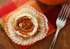 Pumpkin Swirl Cheesecake Yogurt Cupcakes - Cheesecake cups made with light by using Greek yogurt swirled with pumpkin butter on top. Light, creamy and perfect portion control.