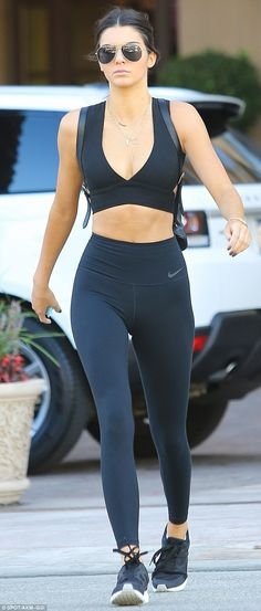 Fitness first: She showed off her toned torso and slimline physique in an all black ensemb...
