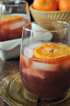 Mulled cranberry juice cocktail with vanilla vodka and fresh oranges. www.mountainmamacooks.com