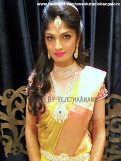 Traditional Southern Indian bride, Akshata wears bridal silk saree and jewellery for her reception.