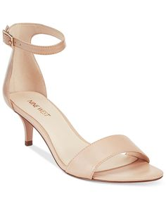 Simply sophisticated and subtly sexy... make every step chic in these two-piece ankle-strap sandals by Nine West. | Leather upper; manmade sole | Imported | Round open-toe sandals with side buckle clo