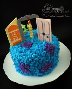 Monster's Inc - While I wanted to do this cake for a long time, buttercream and I don't exactly get along.  Trying to pipe this whole cake, left me with very little hair left.  So glad that it finally all came together.  Doors, Mike and candle are all made out of fondant and gumpste.  TFL  :-)