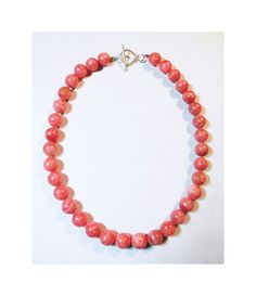 Here we have a beautiful Sterling Silver & Genuine Rhodochrosite bead necklace. The necklace is a total of 18 inches long, including the solid
