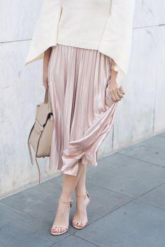 Caroline styles a pink velvet pleated skirt