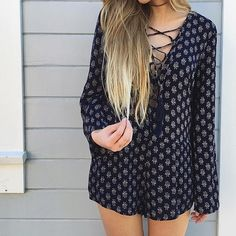 Navy Boho Printed Lace Up Romper Long sleeve romper with a sun burst inspired pattern and a lattice neckline! Perfect for brunch or anytime you just want to feel cute!   •100% rayon •Hand wash cold and line dry! •Imported Pants Jumpsuits & Rompers
