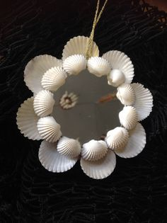 A gorgeous addition to your Christmas Tree. This Seashell Christmas Ornament has…