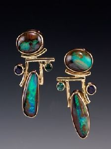 These earrings are constructed in 18 & 14k gold. Each Australian Kuroit Opal cabochon is set in a fabricated bezel of 18k gold. Tube bezel s...