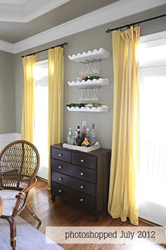 yellow and gray with black furniture-  Ashley and David's guest room